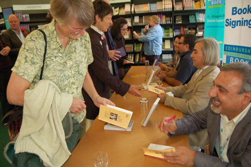 Authors signing the tour's book