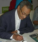 Bahaa Taher signing copies at the Emirates Airline Literature Festival